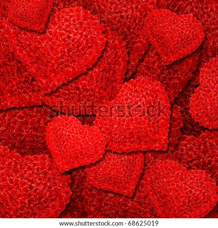 Abstract background from red roses in the form of heart