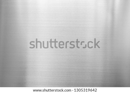 Abstract background from silver metal plate. Shiny surface  material. Modern architecture backdrop.