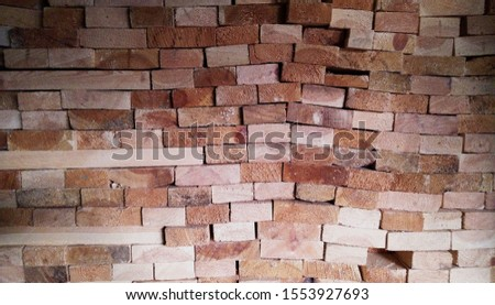 Abstract background from the ends of the old boards. Close-up. Place for text.Stack of square wood planks for furniture materials.Stack of square wood planks for furniture materials.