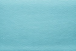 abstract background from the painted texture of skin and leather fabric turquoise color