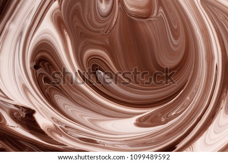 Abstract background, hot melted chocolate and milk splash mixing pattern #1099489592