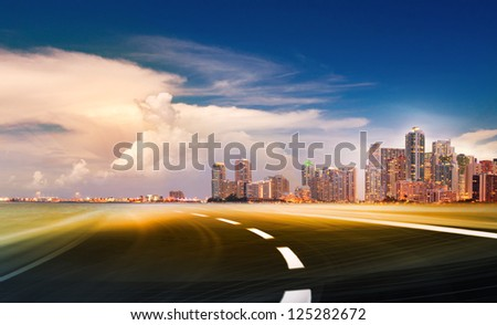 Abstract background illustration of fast highway road motion going to modern city at sunset or sunrise.