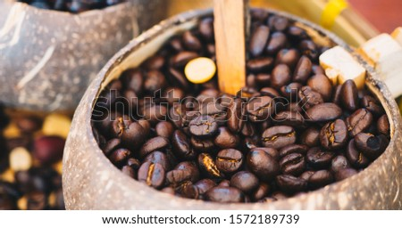 Abstract background image of Roasted coffee beans. Coffee beans photo filtered in vintage style. Mixture of different kinds of coffee beans.