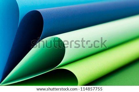 Abstract background in cool colors made with colored paper