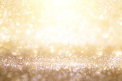 Abstract background in sparkling gold and silver bokeh for a celebratory concept