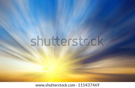 Abstract background in the form of blurred sunset with sun rays