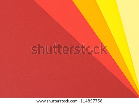 Abstract background in warm colors made with colored paper