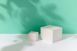 Abstract background mock up with podium for product display with shadows on turquoise. Blank product stand in minimal slyle.