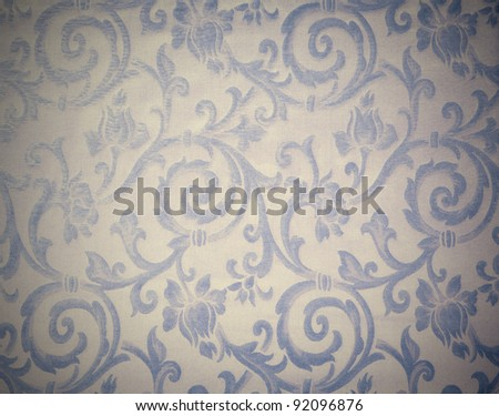 Abstract background of a heavy grey blue brocade fabric with interwoven repeat design.