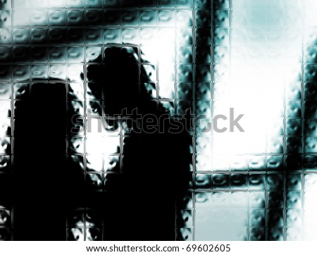 abstract background of a man and a woman behind the glass