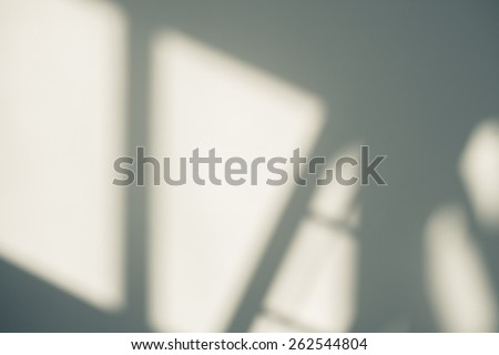 Abstract background of a white wall with shadows from the window.