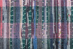 abstract background of an old motley cotton fabric close up