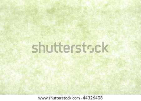 Abstract background of backlit green paper