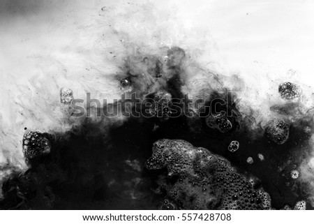 abstract background of  black ink dissolving in water