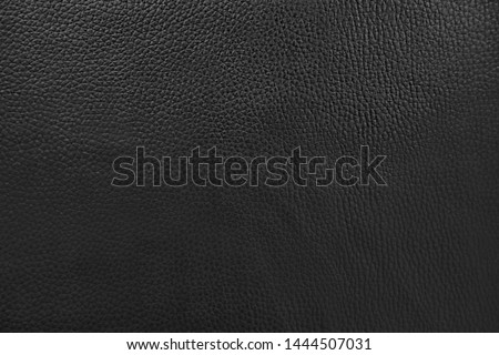 abstract background of black leather for furniture upholstery close up