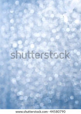 Abstract background of blue glittering lights