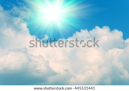 Abstract background of blue sky and white clouds with the sun shining #445531441