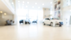 Abstract background of blurred  new cars dealership place