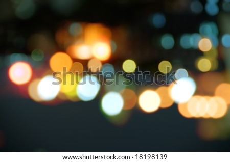 Abstract background of blurred street lights at night