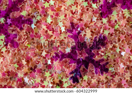 Abstract background of brightly colored plastic stars and snowflakes #604322999