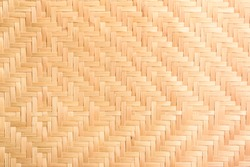 Abstract background of brown woven bamboo, Asian handicrafts, natural materials, products. Sustainability concept.