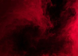 Abstract background of chaotically mixing puffs of red smoke on a dark background