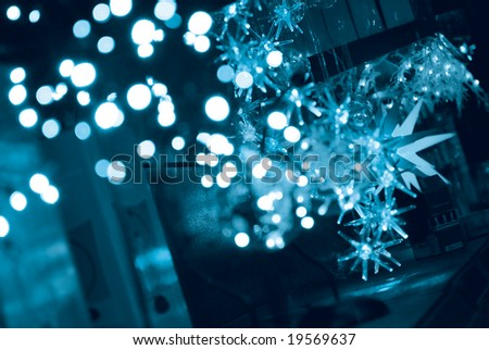 Abstract background of Christmas lights and stars in blue tone