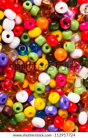 Abstract background of closeup varicolored small beads