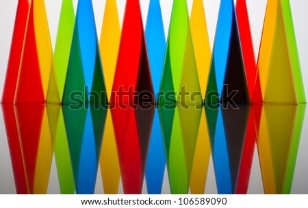 Abstract background of colored glasses of plastic
