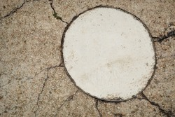 Abstract background of concrete sidewalk, floor, walkway, path, footpath, walkway or walkway. A fragment in the form of a large circle is highlighted on it.