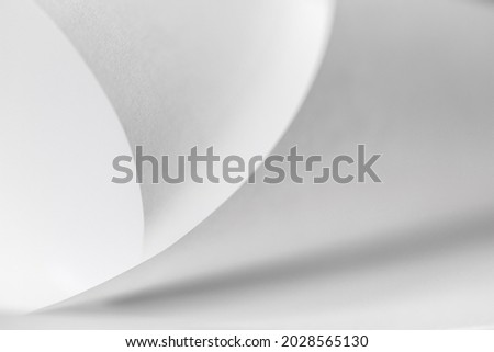 abstract background of curved sheets of paper close-up with a shallow depth of field (blurred) Photo stock ©