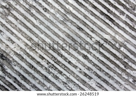 abstract background of diagonal lines in a frozen track