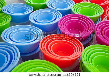 Abstract background of different colored plastic basins at a market