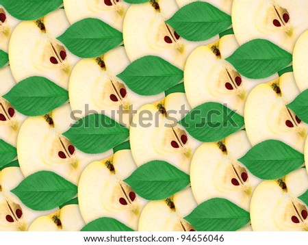 Abstract background of fresh yellow apples slices and green leaf for your design. Close-up. Studio photography. Attention - it is not a seamless pattern.