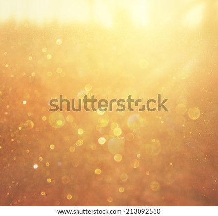 abstract background of golden bokeh lights.