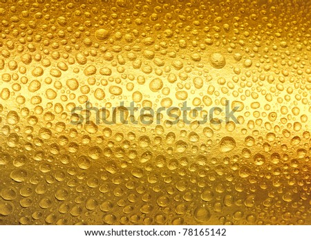 Abstract background of golden drops of water.