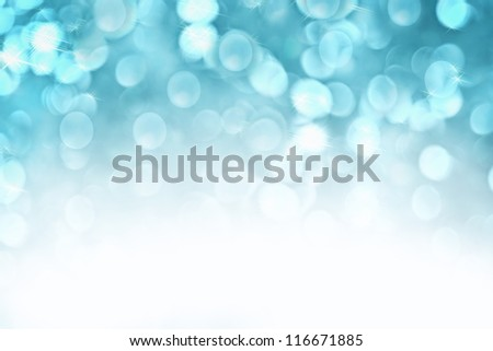 Abstract background of icy blue holiday lights with copy space.
