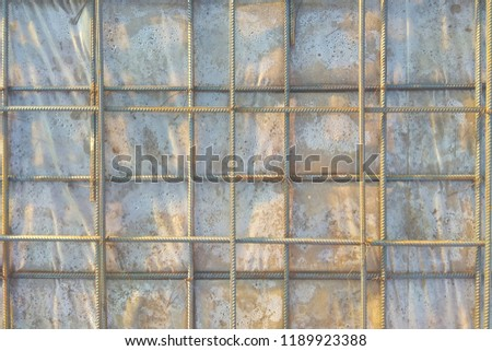 Abstract background of iron armature ready for concreting Metal armature in reinforced concrete structures close-up #1189923388