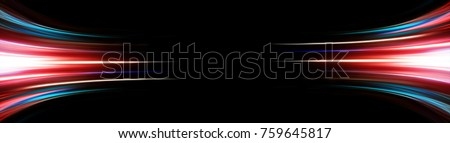 Photo of  Abstract background of long explosure tale light on black ,Technology backgroud