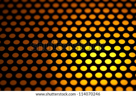 abstract background of metal mesh with orange back lighting