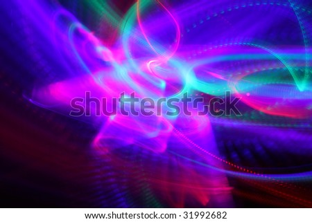 Abstract background of moving colorful lights over black