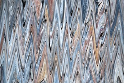 Abstract background of multi-colored vertical zigzags. Top view.