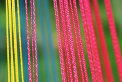 abstract background of multicolored threads. Narrow focus, macro photo. Bright multi-colored threads