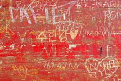Abstract background of old wood surface with carved graffiti