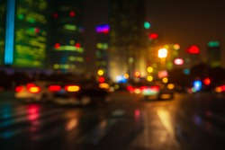 Abstract background of People across the crosswalk at night in Shanghai, China. Perfect background image of blurred night street with unrecognizable people and cars in night illumination