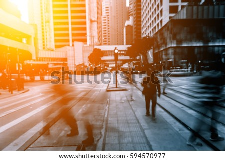 Abstract background of people on the street with sunlight #594570977