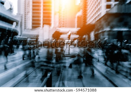 Abstract background of people on the street with sunlight - Shutterstock ID 594571088