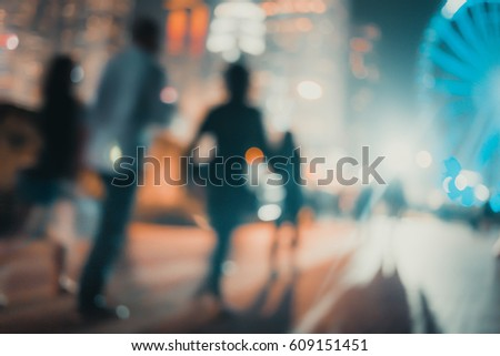 Abstract background of people on the waterfront at friday night