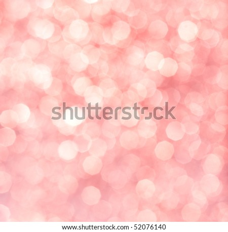 Abstract background of pink glittering lights