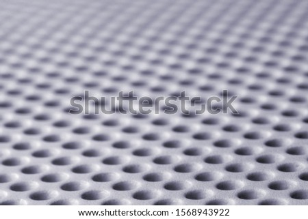 abstract background of round holes, shallow depth of field #1568943922